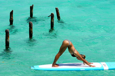 Why surfers are practicing Yoga.